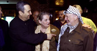 Prime Minister Barak, Secretary Albright, and Chairman Arafat greet each other at dinner